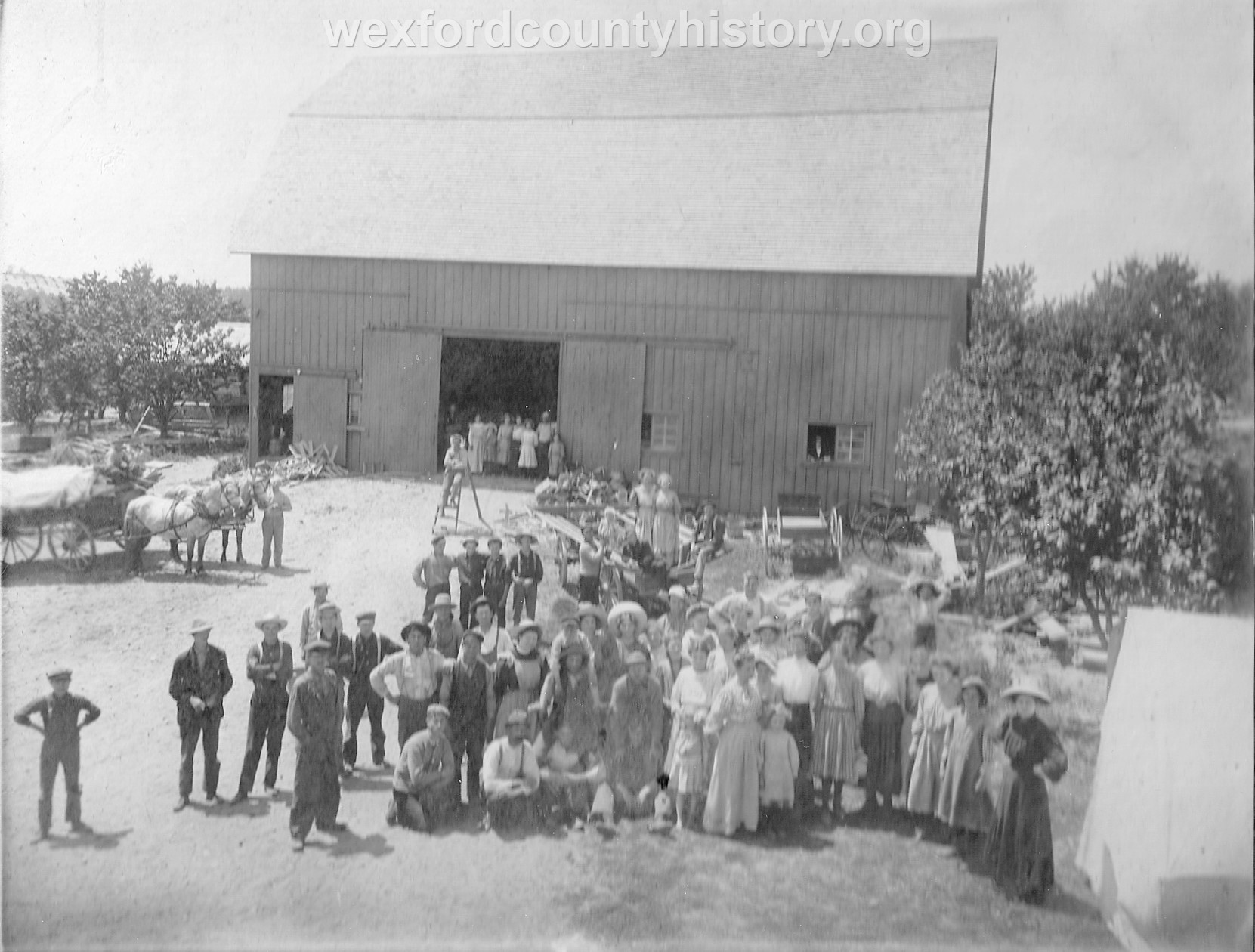 Local Gathering In Front Of A Barn