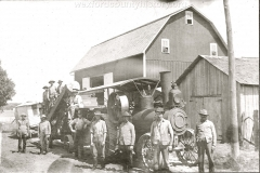 Farmers Pose Next To Their Steam Tractor