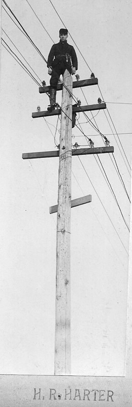 Man on a Power Pole