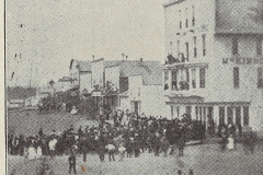 Cadillac-Parade-1877-07-04-Parade-in-front-of-McKinnon-Hotel-1