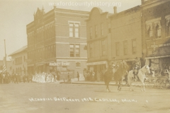 Cadillac-Parade-1912-Memorial-Day-Parade-Intersection-of-Beech-and-North-Mitchell-Street-Masonic-Building-Cummer-Diggins-Office