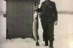 Cadillac-Hunting-And-Fishing-Man-Holding-Fish