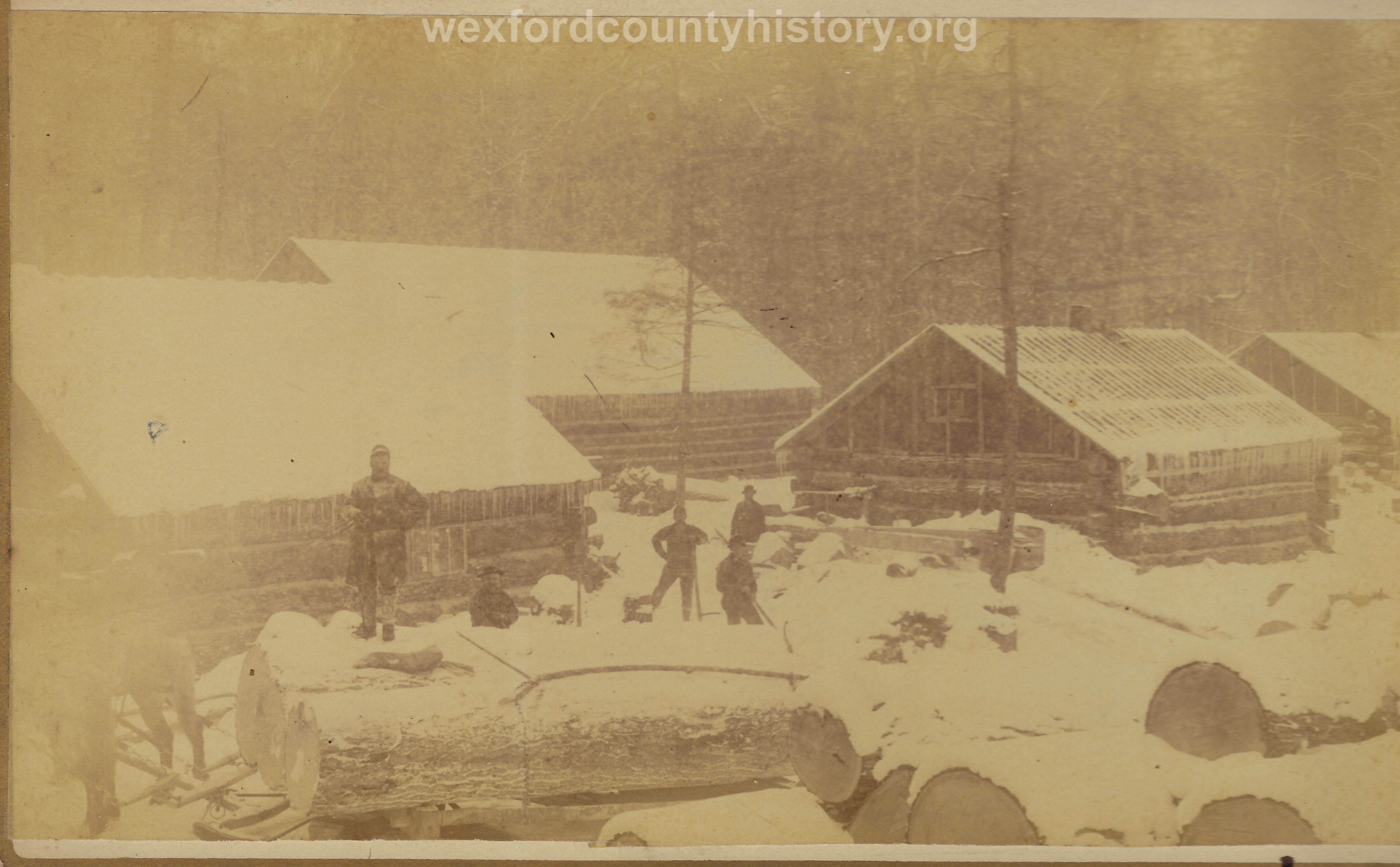 Cadillac-Lumber-Huge-Logs-In-The-Snow-Near-Camp