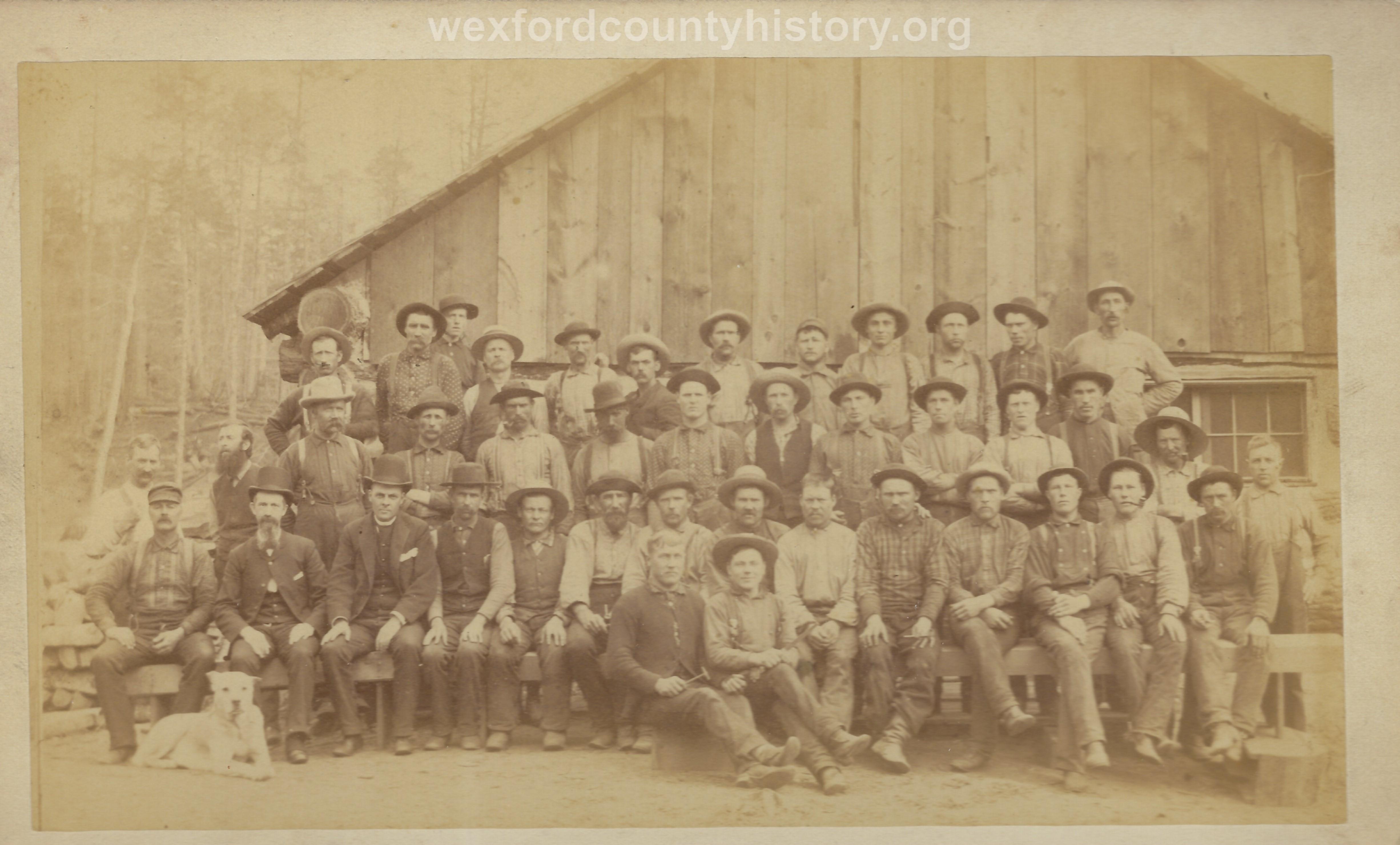 Cadillac-Lumber-Lumberjacks-Posing-In-Front-Of-Camp-Building-2