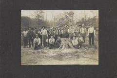Cadillac-Lumber-Crew-Posing-With-Large-Stump