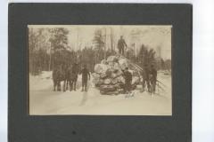 Cadillac-Lumber-Decking-Logs-Onto-A-Railroad-Car