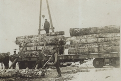 Cadillac-Lumber-Loading-Logs-Onto-Cars-For-Transport