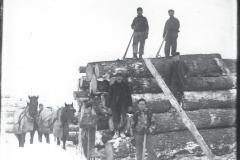 Cadillac-Lumber-Stacking-Logs-1