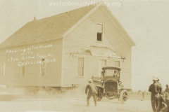 Cadillac-Business-Acme-Truck-Moving-A-House-1
