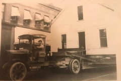 Cadillac-Business-Acme-Truck-Moving-House-From-Jennings-Passing-by-218-North-Mitchell