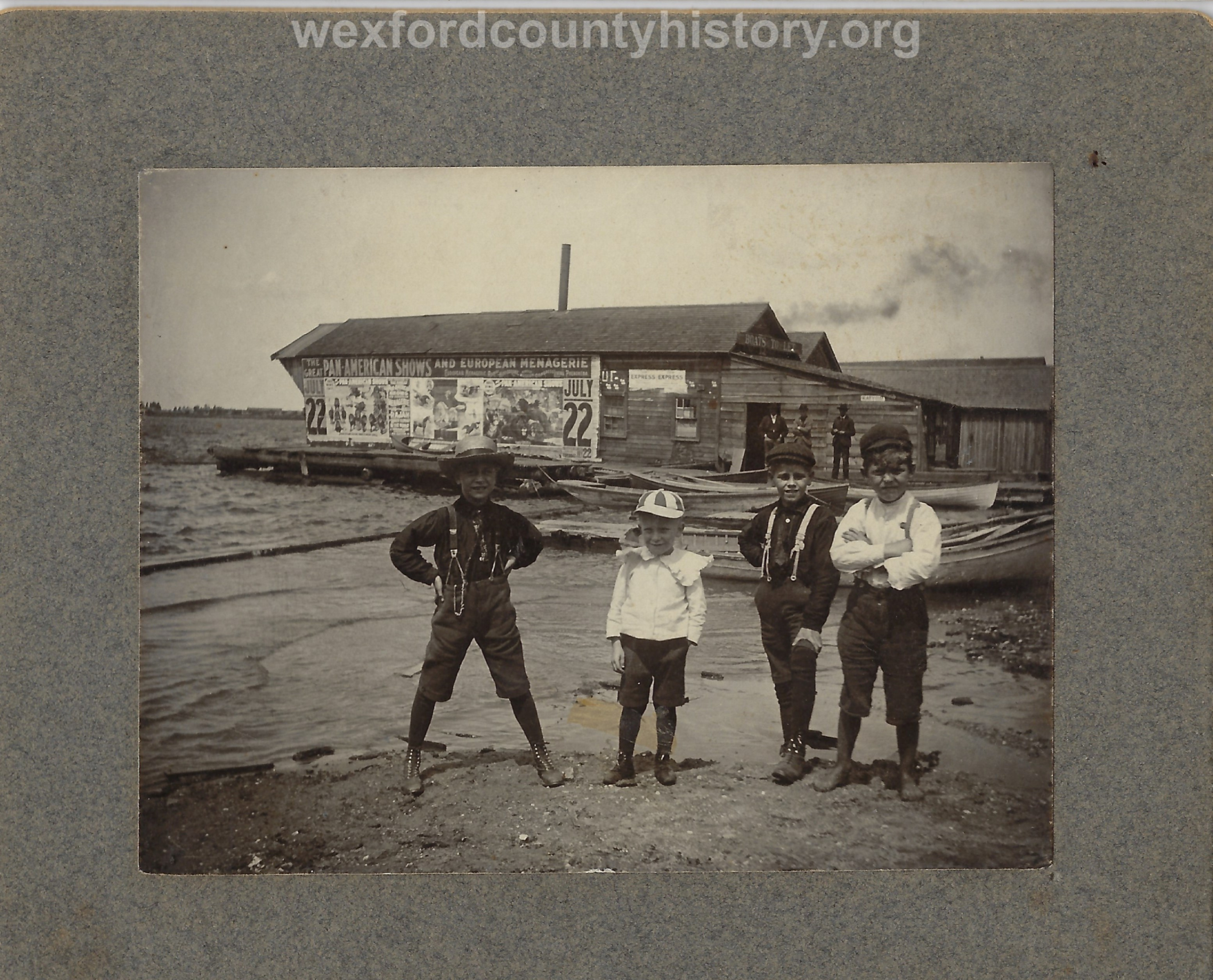 Children In Front Of A Boat Rental Building
