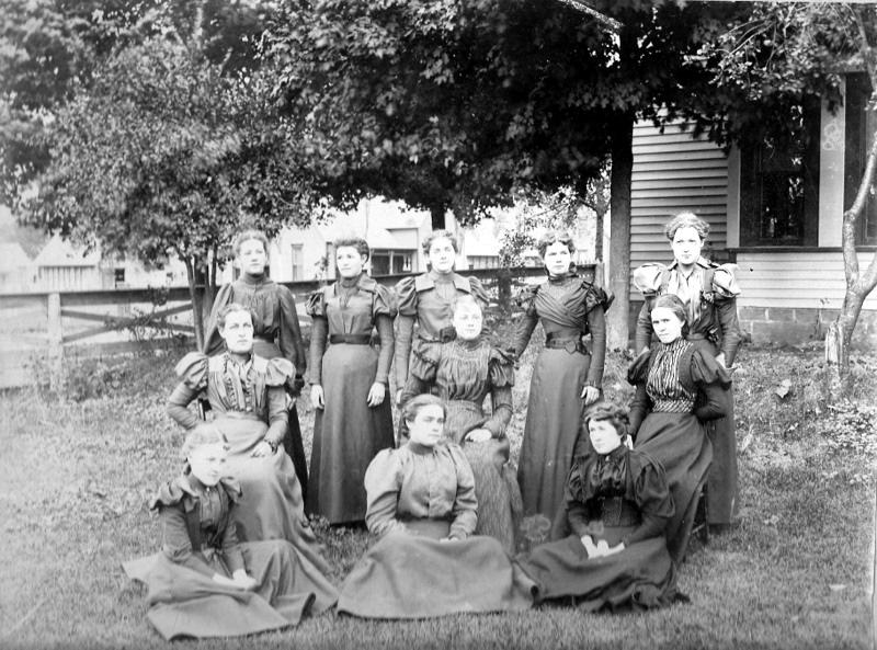 Women Pose in A Yard