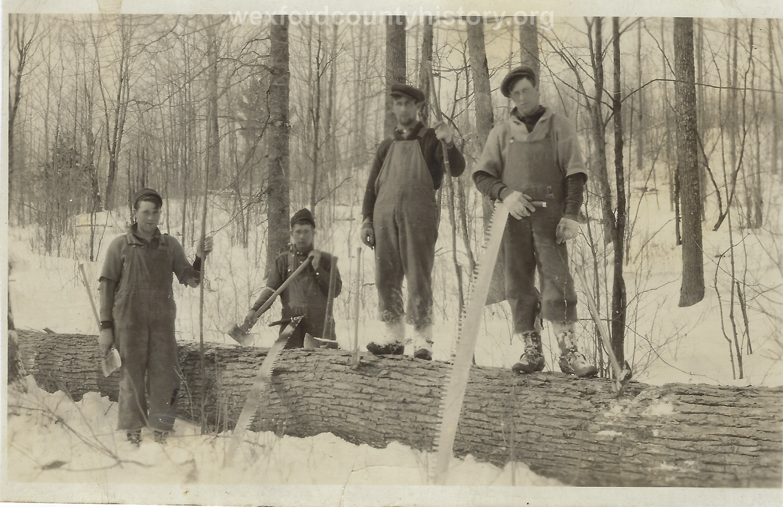 Cadillac-Lumber-Lumberjacks-with-tools-of-the-trade