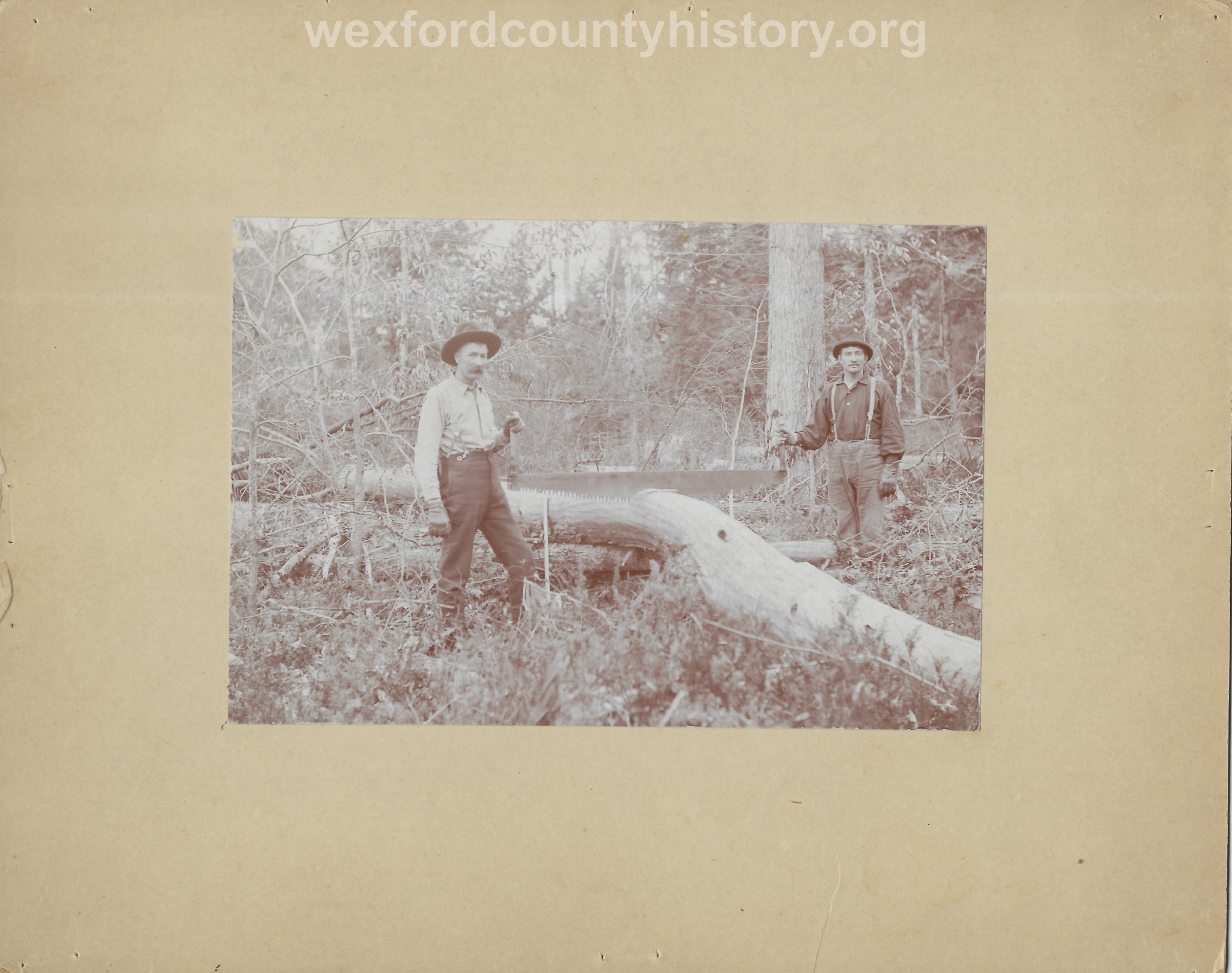 Cadillac-Lumber-Men-Pose-With-Crosscut-Saw