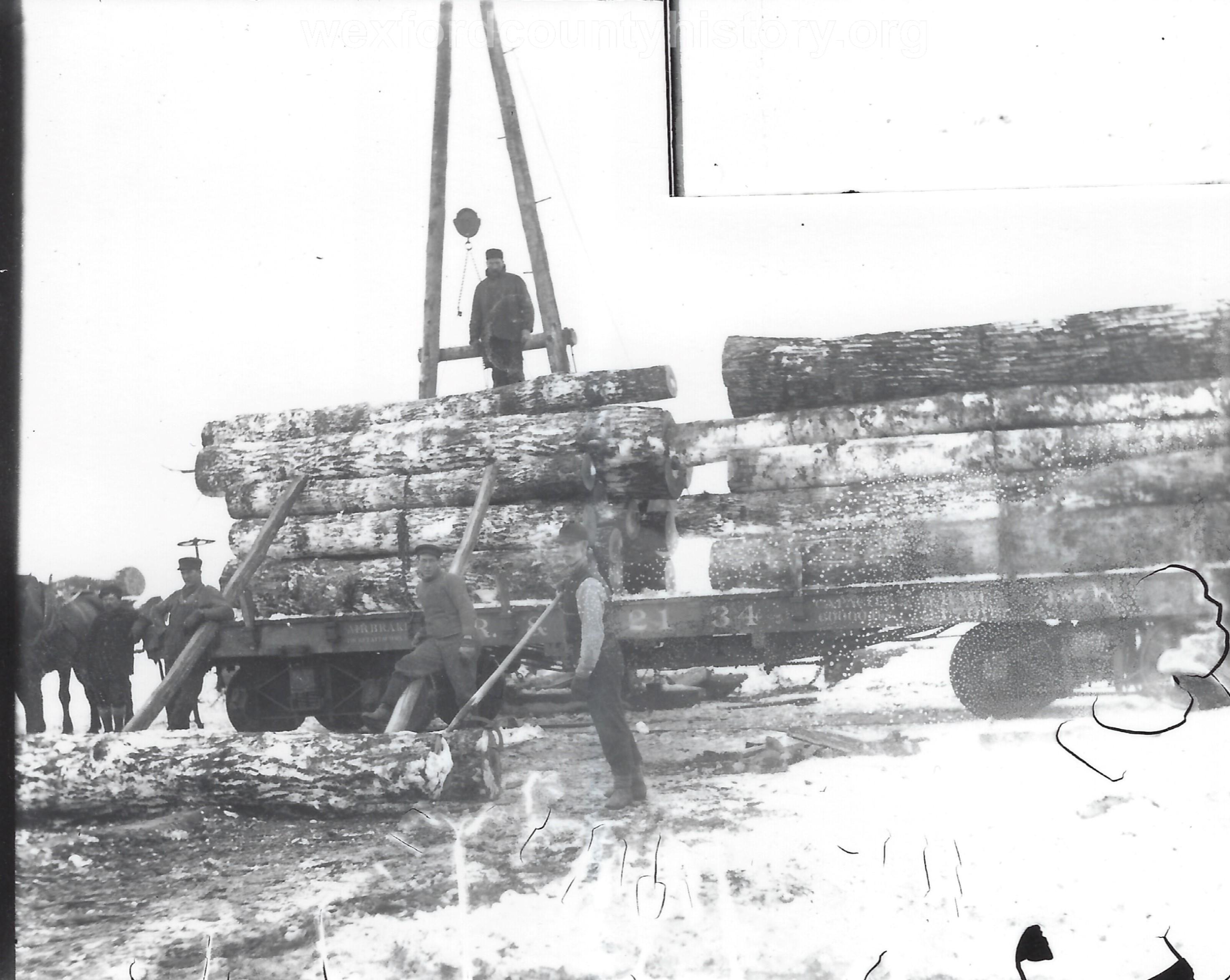 Cadillac-Lumber-Stacking-Logs-2