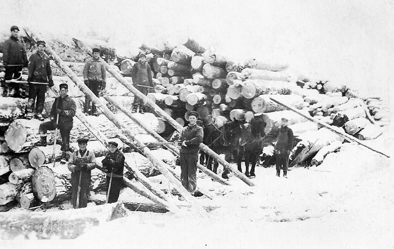 Piling Logs at a Sours Camp