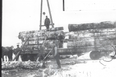 Cadillac-Lumber-Stacking-Logs-2