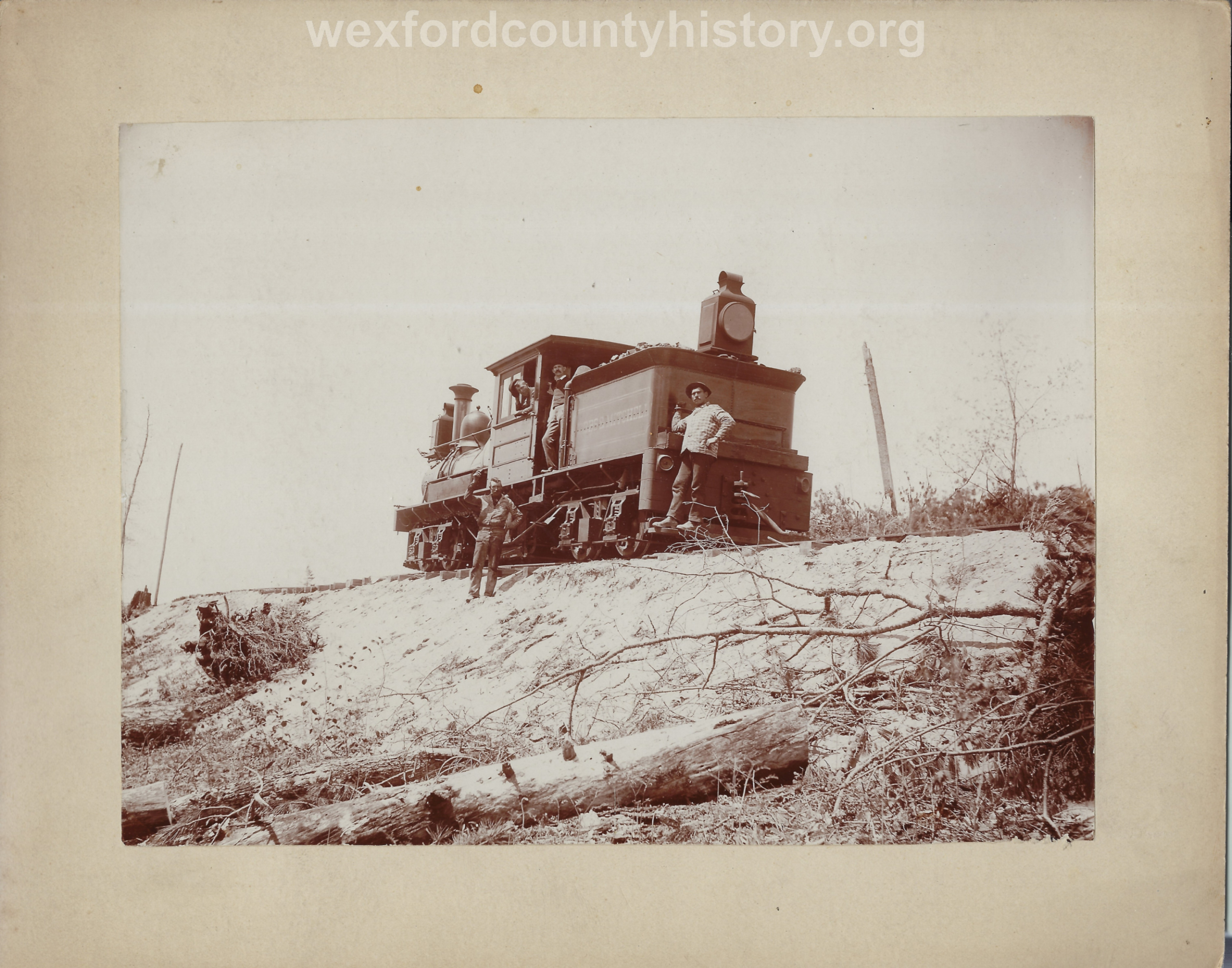 Cadillac-Railroad-Men-Pose-With-A-Cobbs-And-Mitchell-Locomotive