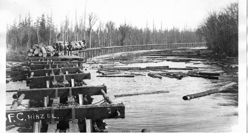 Log Train on a Trestle