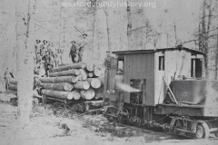 Cadillac-Lumber-Locomotive-And-Car-With-Lumberjacks-On-Stacked-Lumber