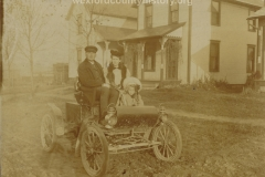 Family In An Early Car
