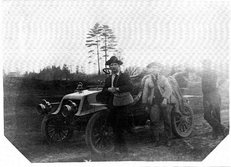 Men and a Motor Car