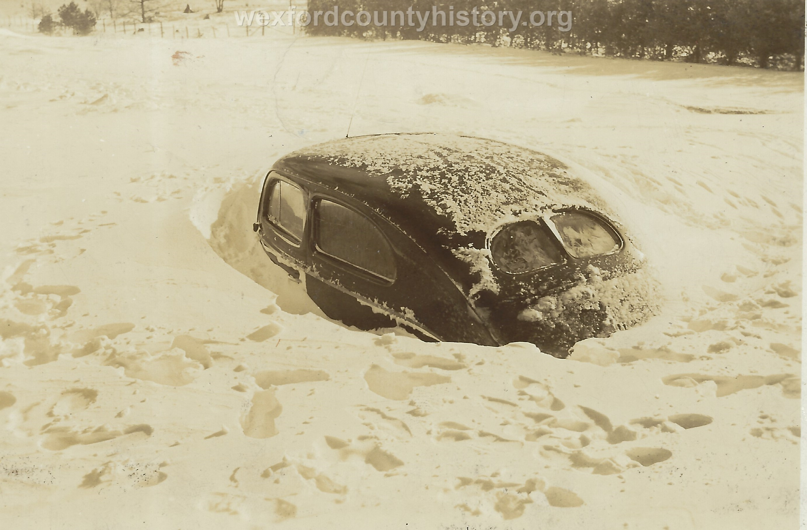 Cadillac-Weather-Car-Buried-In-Snow